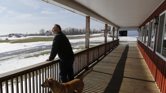 David Johnson looks over a dormant strawberry field at his family's Apple Hills Farm on Thursday, Feb. 14, 2013, in Chenango, N.Y.  Johnson said gas drilling money would allow him to replace some worn-out equipment like the tractor that he has to start with a screwdriver. (AP Photo/Mike Groll)