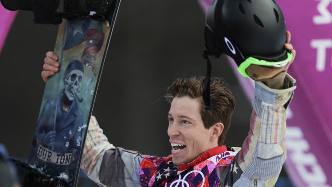 Shaun White of the United States waves to the crowd after a run during the men's snowboard halfpipe qualifying at the Rosa Khutor Extreme Park, at the 2014 Winter Olympics, Tuesday, Feb. 11, 2014, in Krasnaya Polyana, Russia. (AP Photo/Andy Wong)