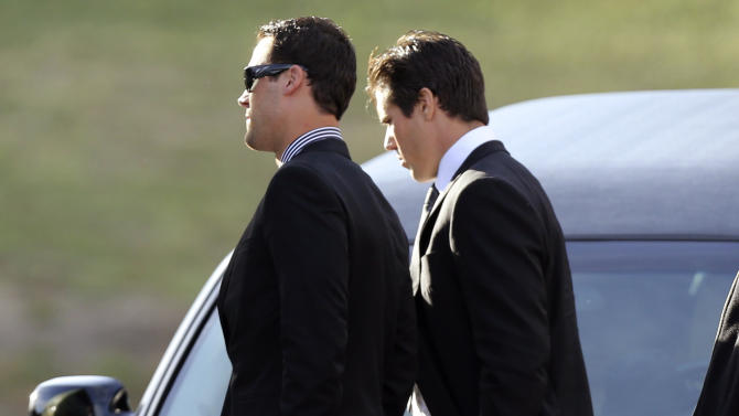 Kansas City Chiefs quarterbacks Brady Quinn, right, and Matt Cassel leave a memorial service for Jovan Belcher at the Landmark International Deliverance and Worship Center, Wednesday, Dec. 5, 2012, in Kansas City, Mo. Belcher shot his girlfriend, Kasandra Perkins, at their home Saturday morning before driving to Arrowhead Stadium and turning the gun on himself. (AP Photo/Ed Zurga)