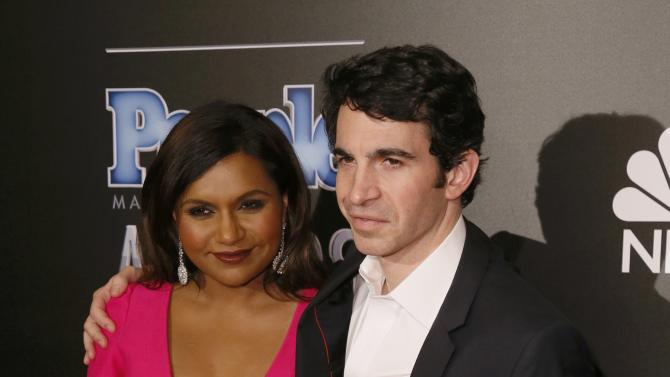 "Actors Kaling and Messina pose backstage with their TV Couple of the Year award for ""The Mindy Project"" at the People Magazine Awards in Beverly Hills"