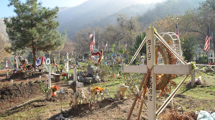 "Shown is the Tule River Indian Reservation's ""lower"" cemetery, one of two, where 8-year-old Alyssa Celaya's grave was to be dug on Monday Dec. 10, 2012. Authorities are piecing together what led a man to kill his mother and two uncles, and shoot his three children before being killed in a shootout with police on Saturday. The violence shook the tiny Tule River Indian Reservation, home to 800 residents. (AP Photo/Tracie Cone)"