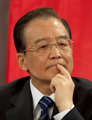 China's Premier Wen Jiabao gestures after the signing of agreements with Chilean President Sebastian Pinera (out of frame) at La Moneda presidential palace in Santiago on June 26. Investors in China have come to expect further monetary easing after the country's leaders, including Wen, expressed concern over weakness in the economy and have hinted at further action to bolster growth