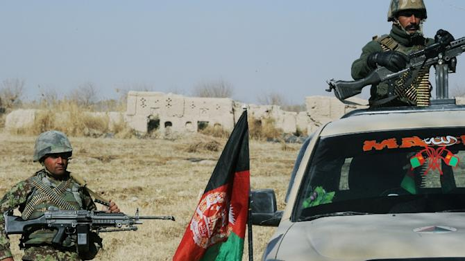 Afghan National Army soldiers keep watch near the remains of the house belonging to Mullah Omar, in the village of Sangesar, in December 2014