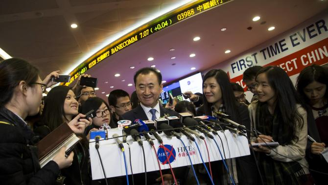 Wang Jianlin, chairman of Wanda commercial properties, speaks to the media during the debut of the company at the Hong Kong Stock Exchange