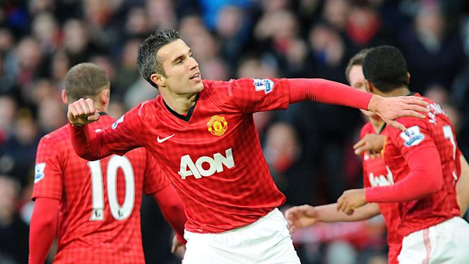 Manchester United's Robin van Persie celebrates scoring against Sunderland during the English Premier League soccer match at Old Trafford, Manchester, England, Saturday Dec. 15, 2012. Manchester United won the match 3-1. (AP Photo/PA, Martin Rickett) UNITED KINGDOM OUT  NO SALES  NO ARCHIVE