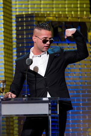 "In a March 9, 2011 photo Mike ""The Situation"" Sorrentino appears onstage at the Comedy Central Roast of Donald Trump in New York.   Abercrombie & Fitch Co. says in a news release Tuesday Aug. 16, 2011 that they are concerned that having Sorrentino  seen in its clothing could cause ""significant damage"" to the company's image, and has offered a payment for him and other cast members of ""Jersey Shore"" to not wear the company's clothes on the show. (AP Photo/Charles Sykes)"