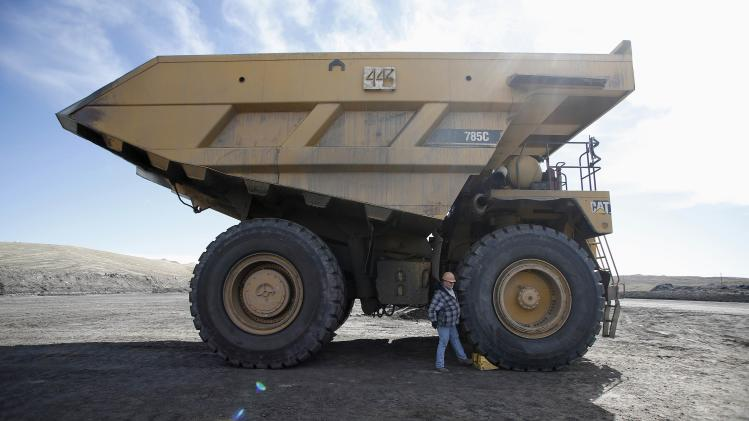 Coal mine truck operator Steve Larsen secures his truck at the Jim Bridger Mine outside Point of the Rocks, Wyoming