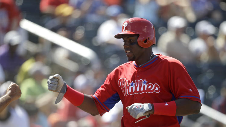 Philadelphia Phillies John Mayberry Jr. celebrates after scoring the tying run in the eighth inning of an exhibition baseball game against the Minnesota Twins in Fort Myers, Fla., Sunday, March 9, 2014. The game ended in a 1-1 tie. (AP Photo/Gerald Herbert)