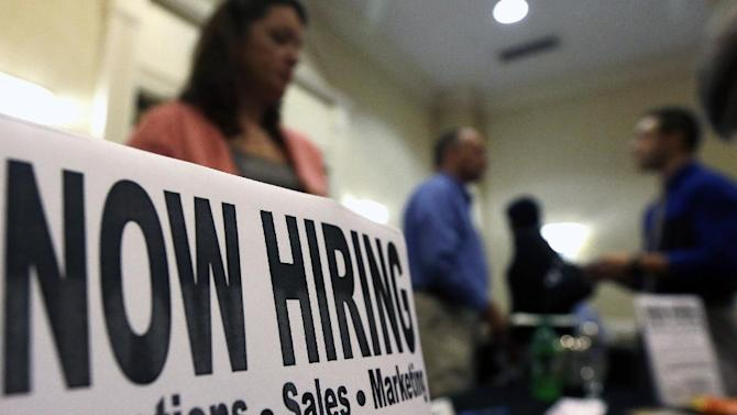 In this Thursday, Oct. 25, 2012, photo, a sign attracts job-seekers during a job fair at the Marriott Hotel in Colonie, N.Y. The October employment report the government will release Friday, Nov. 2, 2012 will likely solidify the picture of the U.S. job market that's emerged this year: Companies are hiring steadily but cautiously. And unemployment remains high. (AP Photo/Mike Groll)