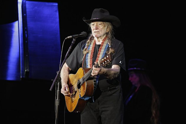 FILE - In this Sunday, Jan. 29, 2012 file photo, country music icon Willie Nelson performs during a fundraising concert for U.S. Rep. Dennis Kucinich in Lorain, Ohio. Nelson&#39;s new album, &quot;Heroes,&quot; released May 15, 2012, is a collection of songs sung with his musical heroes, including Snoop Dogg, Ray Price, Merle Haggard, Joe Shaver, Sheryl Crow, and others. (AP Photo/Mark Duncan, File)