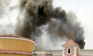 <p>Smoke rises from the Villaggio Mall in Doha after a fire broke out on May 28. Firefighters in Qatar told Wednesday how they tried to rescue 13 children trapped by the blaze in a mall nursery but by the time they reached the toddlers most were dead, huddled in the arms of two fellow firemen who perished during the rescue attempt.</p>
