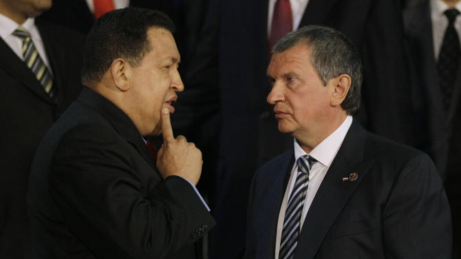 Venezuela's President Hugo Chavez, left, speaks with Igor Sechin, the CEO of Russia's state-controlled Rosneft oil company, after a meeting at Miraflores presidential palace in Caracas, Venezuela, Thursday, Sept. 27, 2012. Chavez has built close ties with Russia, and on Thursday, a joint venture involving state oil company Petroleos de Venezuela SA and a consortium of Russian oil companies began to tap a rich deposit of heavy oil in eastern Venezuela. (AP Photo/Ariana Cubillos)