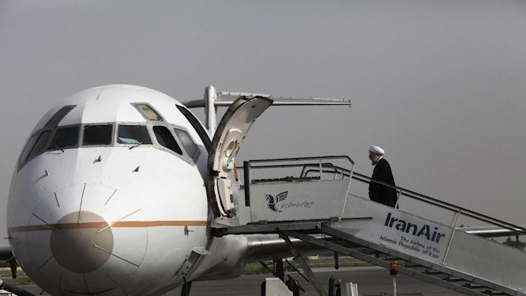 "In this Monday, June 10, 2013 photo, Iranian President elect, Hasan Rouhani, a former Iran's top nuclear negotiator, boards his plane leaving northwestern city of Oroumieh to the city of Tabriz, during his presidential election campaign tour to the northwestern, Iran. Just a week before Iran's election gatekeepers announced the presidential ballot, Rouhani described the U.S. as the world's ""sheriff"" and said direct talks with Washington are the only way for breakthroughs in the nuclear standoff. (AP Photo/Vahid Salemi)"