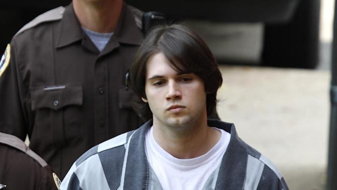 CORRECTS SENTENCE TO 23 YEARS INSTEAD OF 26 YEARS - Former Virginia lacrosse player and convicted murderer George Huguely V is led to court for his sentencing in Charlottesville, Va., Thursday, Aug. 30, 2012. Huguely was sentenced to 23 years in prison for the alcohol-fueled beating death of his ex-girlfriend in 2010.  (AP Photo/Steve Helber)