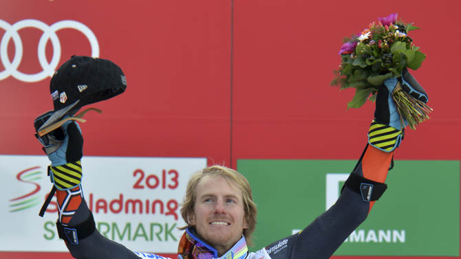 United States' Ted Ligety celebrates winning the gold medal after the second run of the men's giant slalom  at the Alpine skiing world championships in Schladming, Austria, Friday, Feb. 15, 2013. (AP Photo/Kerstin Joensson)