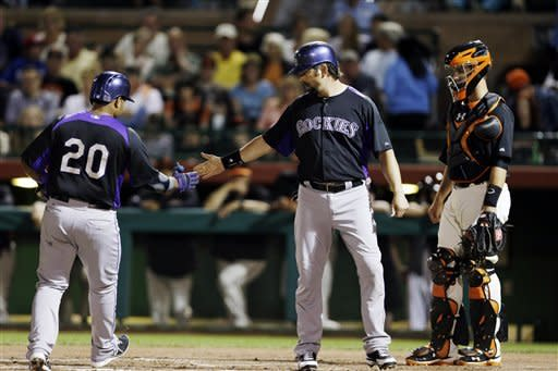 Rosario homers off Cain in Rockies' win