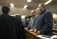 <p>Mike du Toit (right) and his brother Andre du Toit stand in the courtroom at the Pretoria Hight Court. A South African court Friday convicted a second man of high treason in a white supremacist plot to kill Nelson Mandela and drive blacks out of the country in a trial that has spanned nearly a decade.</p>