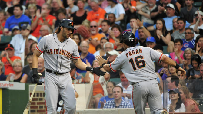 The San Francisco Giants' Angel Pagan (R) and Michael Morse during their game against the Chicago Cubs in Chicago, Illinois on August 20, 2014
