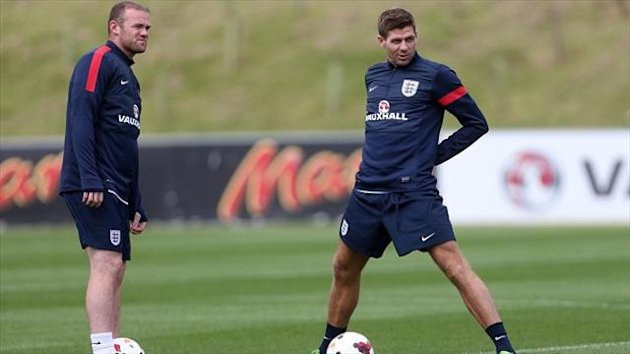 Steven Gerrard, right, believes England's game with Scotland is perfect for Wayne Rooney, left,