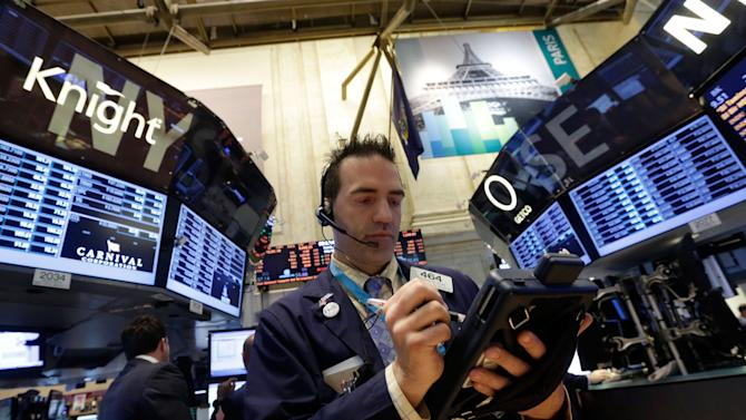 FILE-In this Tuesday, May 28, 2013, file photo, Trader Gregory Rowe works on the floor of the New York Stock Exchange. Global stocks rose Monday June 10, 2013 after U.S. jobs data helped allay concern the Fed might wind down its stimulus and Japan's prime minister promised new tax cuts. (AP Photo/Richard Drew, File)