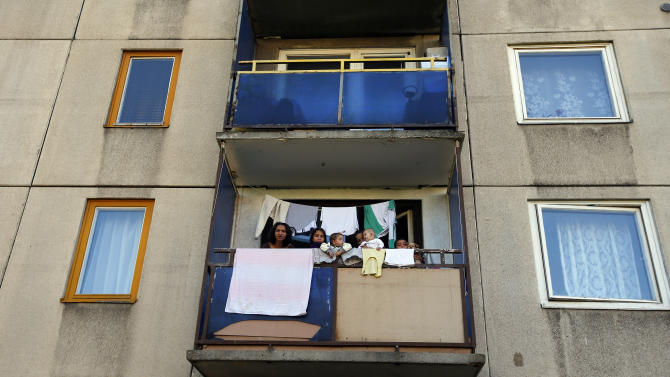 A Roma family gathers at the balcony of their apartment at the Avas apartment projects in Miskolc