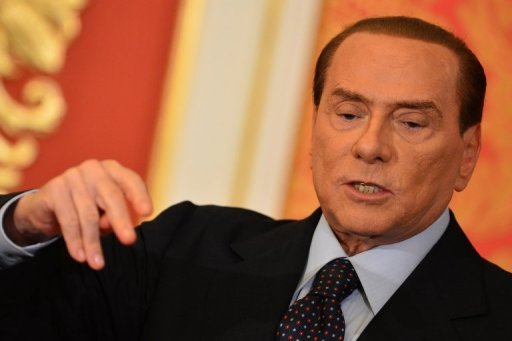<p>Former Italian premier Silvio Berlusconi speaks during a press conference in Monza on October 27. Italian police say Berlusconi's accountant was taken hostage in his home by armed intruders who demanded a 35 million euro ($44 million) ransom from the ex-premier.</p>