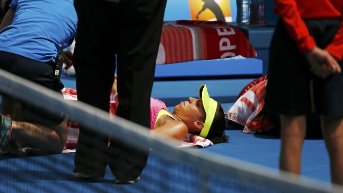 Keys of the U.S. receives medical attention during her women's singles quarter-final match against compatriot Venus at the Australian Open 2015 tennis tournament in Melbourne