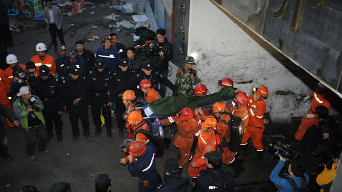 Trapped China miners rescued after almost 60 hours