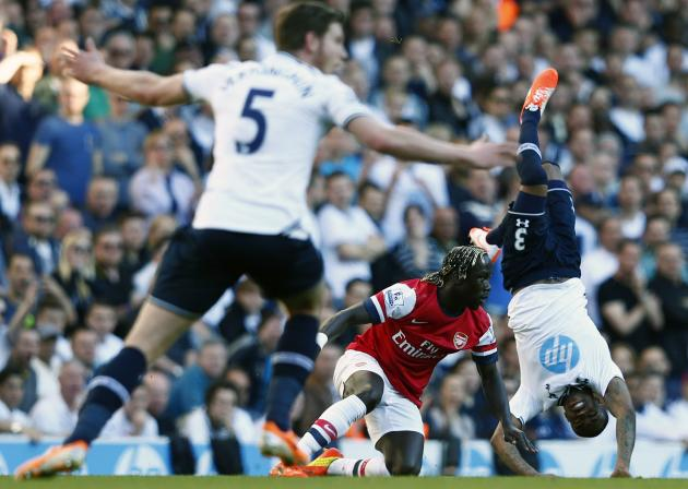 Arsenal's Sagna challenges Tottenham Hotspur's Rose during their English Premier League soccer match in London