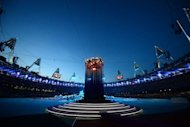 View of the Olympic flame burning in the Olympic stadium prior to the start of the closing ceremony of the 2012 London Olympic Games in London