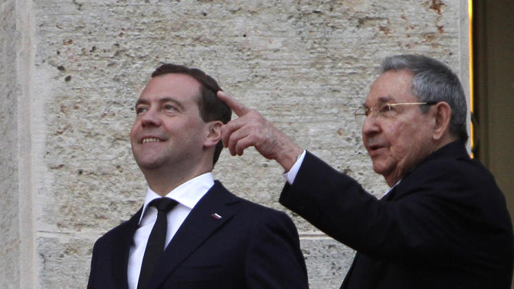 Cuba's President Raul Castro, right, and Russia's Prime Minister Dmitry Medvedev, left, speak after a wreath-laying ceremony at the Jose Marti monument in Havana, Cuba, Thursday, Feb. 21, 2013. (AP Photo/Ismael Francisco, Cubadebate)