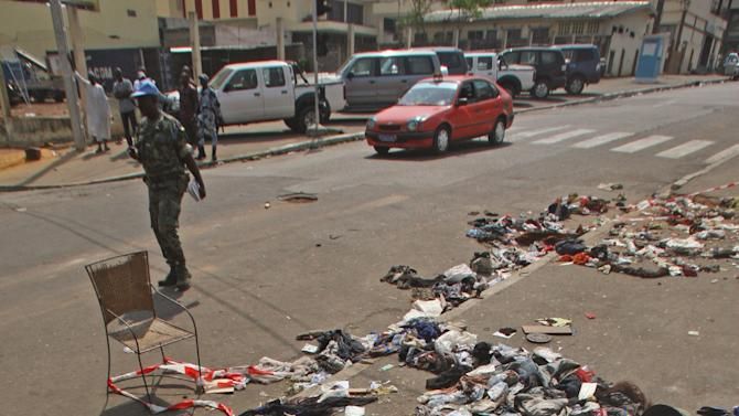 The belongings of people that were involved in a stampe lies on the ground  in Abidjan, Ivory Coast, Tuesday, Jan 1 2013. At least 61 people were killed early Tuesday in a stampede following a New Year's fireworks display in Abidjan, Ivory Coast's commercial center, said officials. The death toll is expected to rise, according to rescue workers. The majority of those killed were young people between eight and 15 years old who were trampled after the fireworks festivities in Abidjan's Plateau district, at about 1 a.m. Tuesday, said Col. Issa Sako, of the fire department rescue team. (AP Photo/Emanuel Ekra)