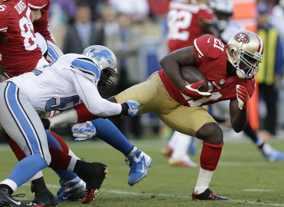 San Francisco 49ers running back Frank Gore, right, runs with the ball but is stopped by Detroit Lions outside linebacker Justin Durant, left, during the first quarter of an NFL football game in San Francisco, Sunday, Sept. 16, 2012. (AP Photo/Marcio Jose Sanchez)