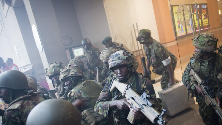 Armed police leave after entering the Westgate Mall in Nairobi, Kenya Saturday, Sept. 21, 2013. Gunmen threw grenades and opened fire Saturday, killing at least 22 people in an attack targeting non-Muslims at an upscale mall in Kenya's capital that was hosting a children's day event, a Red Cross official and witnesses said. (AP Photo/Jonathan Kalan)