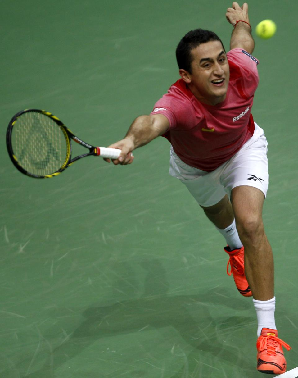 Spain's Nicolas Almagro returns a ball to Czech Republic's Tomas Berdych during their Davis Cup finals tennis singles match in Prague, Czech Republic, Friday, Nov. 16, 2012. (AP Photo/ Marko Drobnjakovic)