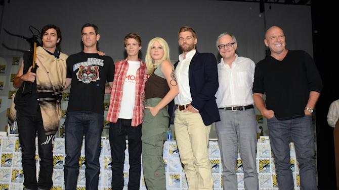 """Alexander Koch, from left, Eddie Cahill, Colin Ford, Rachelle Lefevre, Mike Vogel, Neal Baer and Dean Norris attend the """"Under the Dome"""" panel on Day 1 of Comic-Con International on Thursday, July 24, 2014, in San Diego. (Photo by Tonya Wise/Invision/AP)"""