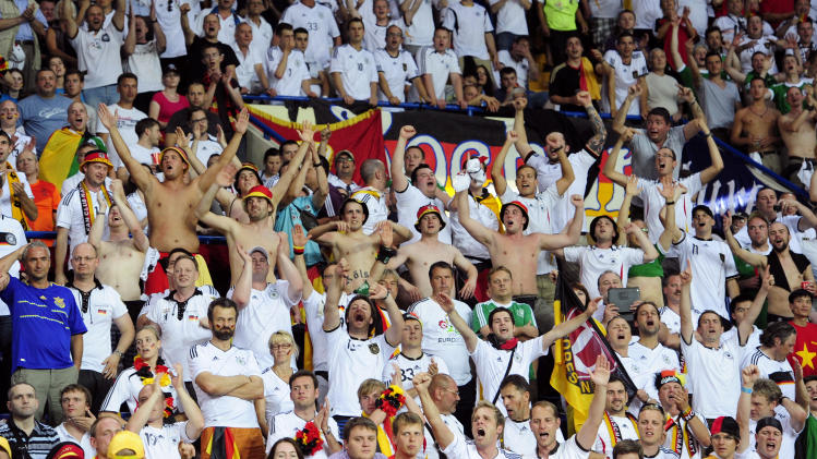 Germany fans cheer  during the Euro 2012 soccer championship Group B match between the Netherlands and Germany in Kharkiv, Ukraine, Wednesday, June 13, 2012. (AP Photo/Manu Fernandez)
