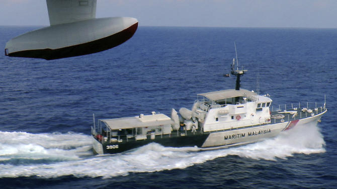 In this photo released by Malaysian Maritime Enforcement Agency, a patrol vessel of Malaysian Maritime Enforcement Agency searches for the missing Malaysia Airlines plane off Tok Bali Beach in Kelantan, Malaysia, Sunday, March 9, 2014. Military radar indicates that the missing Boeing 777 jet may have turned back, Malaysia's air force chief said Sunday as scores of ships and aircraft from across Asia resumed a hunt for the plane and its 239 passengers. (AP Photo/Malaysian Maritime Enforcement Agency)