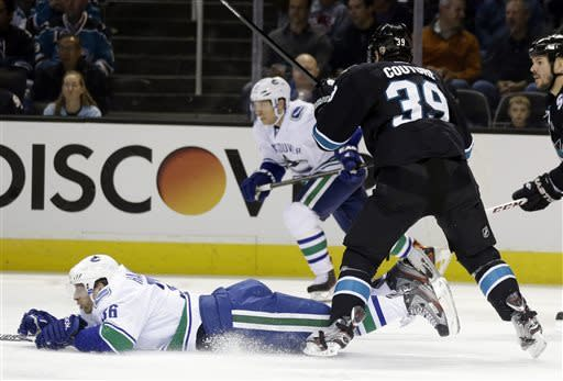 Sharks sweep Canucks with 4-3 win in OT