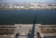 In this March 9, 2011 photo, a shadow of the 170-meter (560-foot) Juche Tower is cast over the Taedong River in Pyongyang, North Korea. (AP Photo/David Guttenfelder)