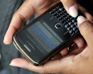 A woman uses her BlackBerry phone. Computer scientists have developed a mobile phone app that can predict the tone of incoming messages before a user reads them so that they are not caught off guard by angry or hostile words