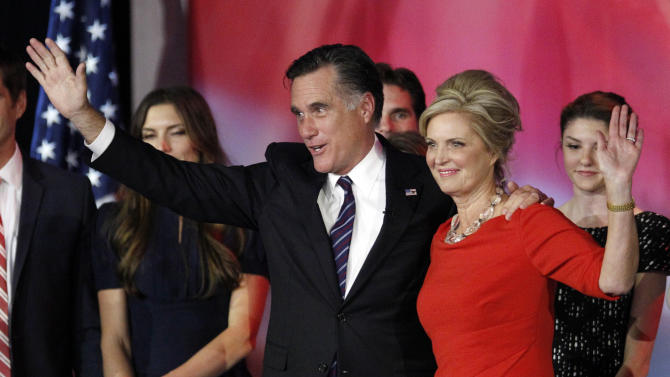 Republican presidential candidate and former Massachusetts Gov. Mitt Romney and his wife Ann Romney wave to supporters after Romney conceded the race at his election night rally, Wednesday, Nov. 7, 2012, in Boston. (AP Photo/Stephan Savoia)