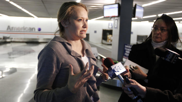 Bethany Christakos, a passenger on an American Airlines flight from Dallas to Chicago, talks to reporters upon landing in Chicago, after the the flight was disrupted when a flight attendant ranted about the plane crashing, on Friday, March 9, 2012. The incident happened while the plane was preparing to take off from Dallas-Fort Worth International Airport. (AP Photo/M. Spencer Green)