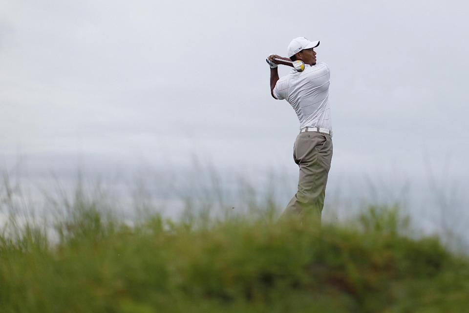 Tiger Woods watches his drive from the 11th tee during a practice round for the PGA Championship golf tournament on the Ocean Course of the Kiawah Island Golf Resort in Kiawah Island, S.C., Wednesday, Aug. 8, 2012. (AP Photo/Evan Vucci).(AP Photo/Evan Vucci)