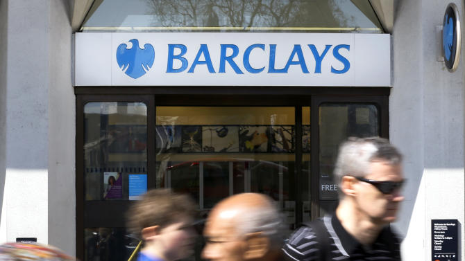 Pedestrians pass a branch of Barclays Bank, in London, Wednesday, April 24, 2013. Barclays PLC on Wednesday reported a return to profit in the first quarter, as it tries to restructure and get past recent scandals. In the three months ending March 31, Barclays made an adjusted profit after tax of 839 million pounds ($1.3 billion). That contrasted with a 589 million pound loss a year earlier and came despite a 5 percent fall in income to 7.7 billion pounds. (AP Photo/Kirsty Wigglesworth)