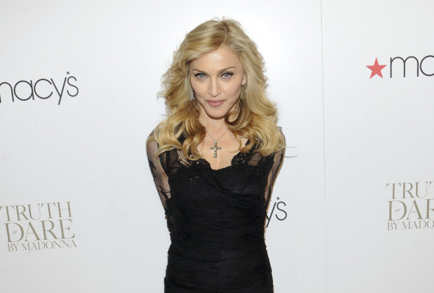 FILE - In this April 12, 2012, file photo, Madonna arrives at Macy&#39;s Herald Square in New York. Israelis are gearing up to get down at Madonna&#39;s show as the pop diva landed in the holy land Friday, May 25, 2012 ahead of her world tour which kicks off here next week. (AP Photo/Evan Agostini, File)