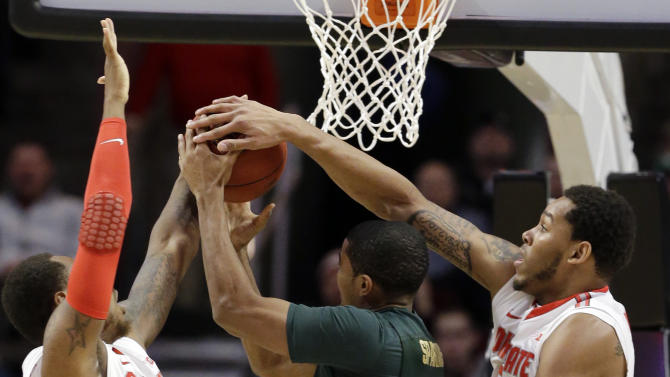 Michigan State's Gary Harris has a shot blocked by Ohio State's Amir Williams and Deshaun Thomas, left, during the first half of an NCAA college basketball game at the Big Ten tournament Saturday, March 16, 2013, in Chicago. (AP Photo/Nam Y. Huh)