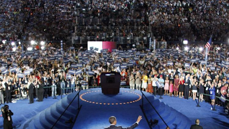 "FILE - In this Aug. 28, 2008, file photo Democratic presidential candidate, Sen. Barack Obama, D-Ill., waves to the crowd as he prepares to address the Democratic National Convention at Invesco Field in Denver, Colo. Obama's own road has been steep from Denver to Charlotte, N.C., where he will accept his party's nomination again in September. People remember the hope and the history. For him or against him, they picture candidate Obama as the one who stood on the Democrats' stage in Denver and declared, ""It's time for us to change America."" Forgotten, it seems, is what Obama said after he actually won. In November, four years ago, he said solemnly that the road ahead would be long. In his words, ""We may not get there in one year, or even one term."" (AP Photo/Scott Andrews and Chuck Kennedy, Pool)"