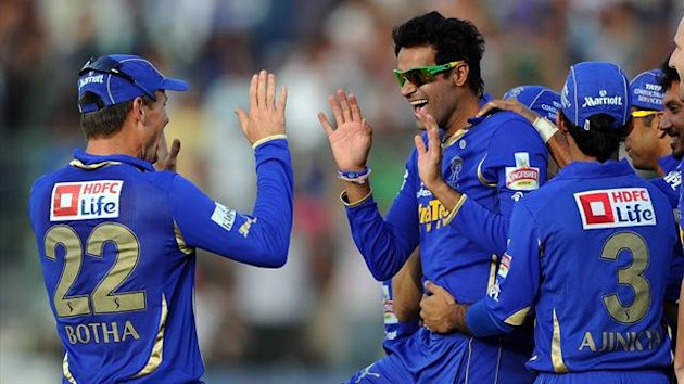 Rajasthan Royals bowler Ajit Chandila (2nd L) celebrates taking the wicket of Pune Warriors batsman Robin Uthappa with teammates during the IPL Twenty20 match between Rajasthan Royals and Pune Warriors