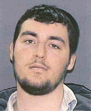 "FILE - This May 16, 2008 file photo provided by the New York City Police Department shows Yitzchak Shuchat. Shuchat has been extradited from Israel to face charges stemming from a 2008 attack on Andrew Charles, who was sprayed with mace and beaten with a nightstick in what an official called ""an unprovoked attack."" Brooklyn prosecutors say Shuchat pleaded not guilty, Friday, July 18, 2014 to second-degree assault as a hate crime, attempted assault and other charges. (AP Photo/NYPD)"